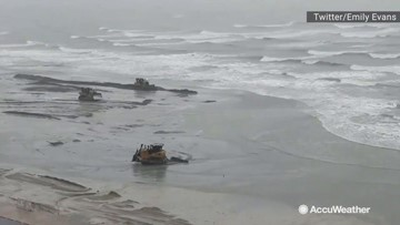 Bulldozers build up beach during Tropcial Storm Imelda