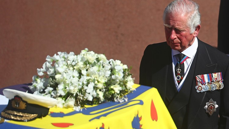 Prince Philip laid to rest in ceremony praising his courage and support for the queen