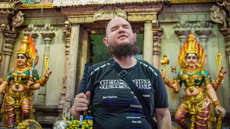 He's blind, severely deaf and traveling alone to every country in the world