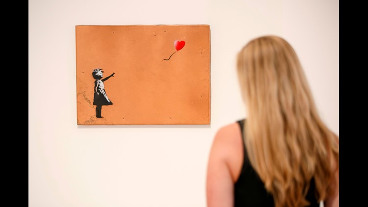 Banksy artwork shreds itself after £1m sale at Sothebys