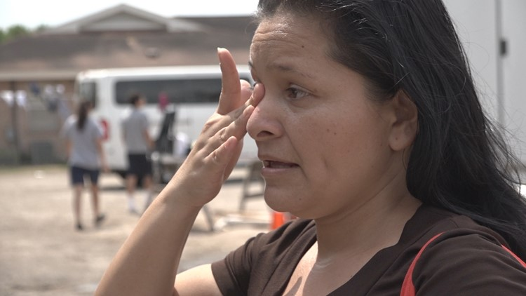 Rosario Herrera from El Salvador wipes off tear talking about the help she received at the respite center