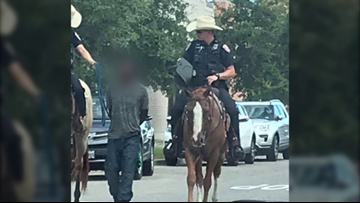 Texas police chief apologizes for photo of mounted officers leading handcuffed man by rope
