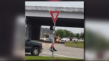 Cops called after guy left duct-taped to a sign