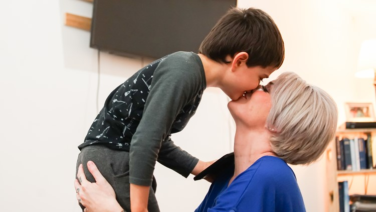 Noah Lopez-Legg, a 6-year-old non-verbal boy with severe autism, kisses his mom Lindsay Legg at their Redmond apartment on March 27, 2018. (Taylor Mirfendereski | KING 5)