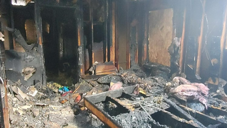 'It takes some of the pain away': Firefighters bring gifts to North Idaho family who lost house in fire