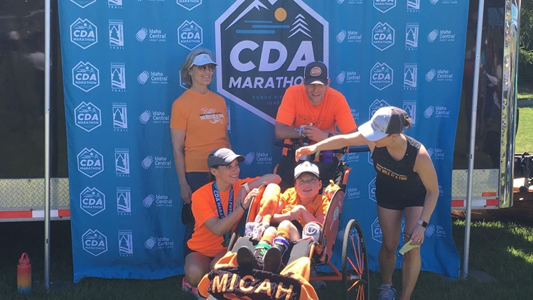 'This amazing little guy': Family of 11-year-old born almost two months premature finishes 9th Coeur d'Alene Marathon