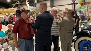 Vietnam War-era veterans honored at Warhawk Air Museum pinning ceremony