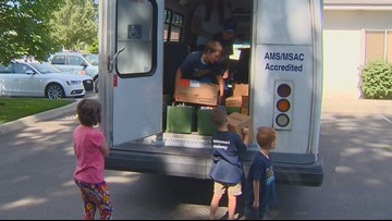 Kids from Montessori Academy in Eagle donate nearly 100 books to a Boise learning center