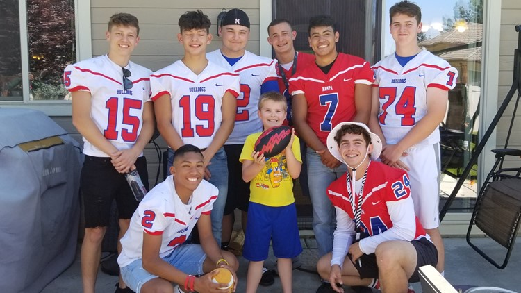 Nampa High School football team shows up at a boy's birthday party after finding out most of the people invited weren't coming