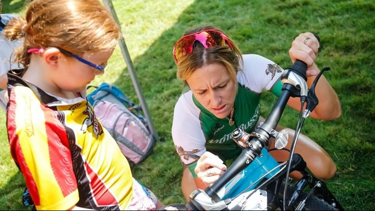 Olympic gold medalist Kristin Armstrong signs an autograph for a young fan before the start of the Kids' Ride at the 2017 Twilight Criterium. (Photo: Downtown Boise Association)