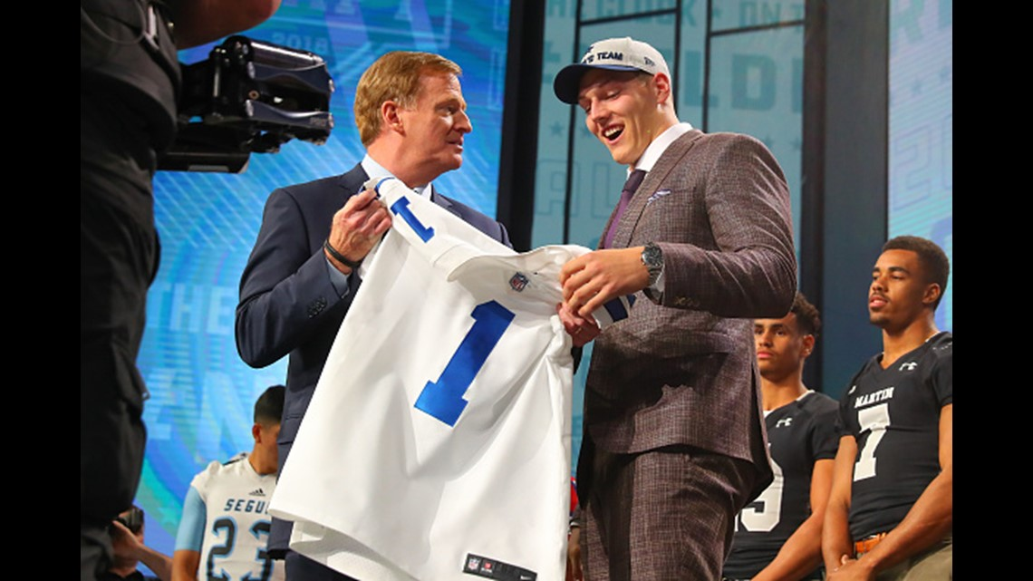 Leighton Vander Esch holds up a jersey with NFL Commissioner Roger Goodell  after being chosen by the Dallas Cowboys with the 19th pick during the first  ... f40c73eb6