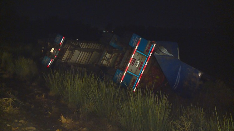 A truck driver hauling onions escaped injury when his semi truck went off the road and overturned Thursday night.
