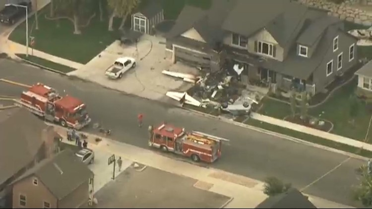 Pilot dies after plane crashes into home with couple inside