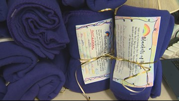 Hillsdale Elementary students giving Blankets of Hope to the homeless to spread kindness