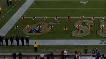 49ers cheerleader takes knee during anthem