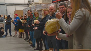 Micron employees make big turkey donation to Idaho Foodbank