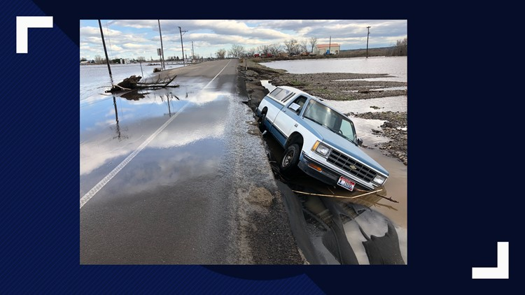 Car off flooded road in Weiser
