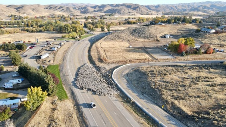 Herd of sheep cross Idaho Highway 55, with the help of Eagle Police