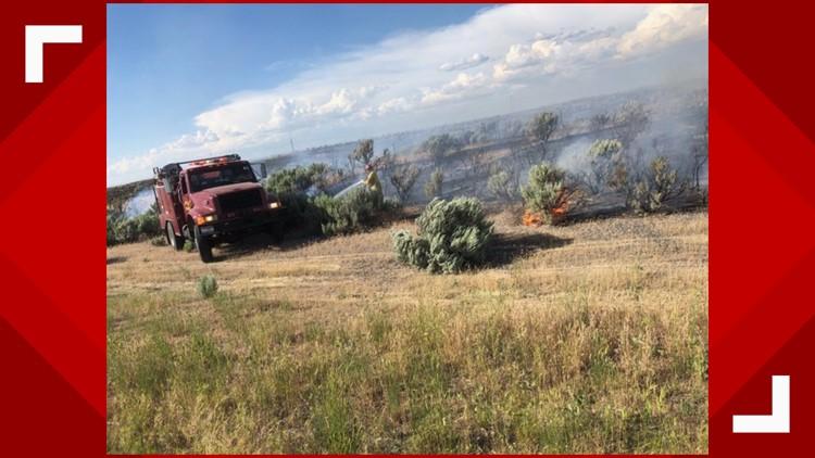 Crews battle brush fire along I-84 near Jerome