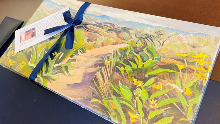 Boise Mayor McLean gifts President Biden a painting of the foothills
