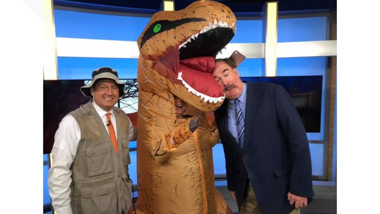 KTVB anchor Maggie O'Mara dressed up in a dinosaur costume on TV