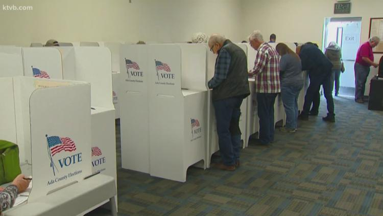 As mail voting pushed, some fear loss of in-person option