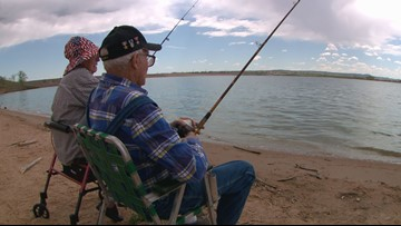 'Oh, I caught her': 104-year-old veteran fishes with 94-year-old girlfriend by his side