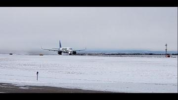 First flight departs Denver International Airport following 'bomb cyclone'
