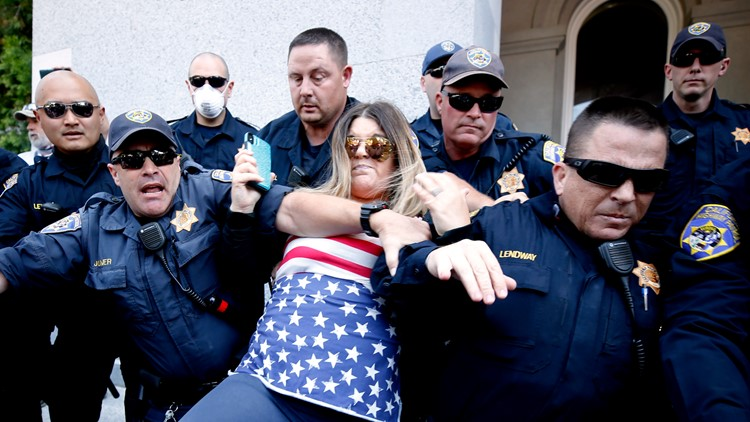 Dozens arrested after hundreds storm California's Capitol to protest stay-at-home orders