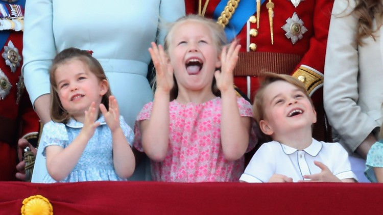 Princess Charlotte of Cambridge, Savannah Phillips, Prince George of Cambridge watch the flypast on the balcony of Buckingham Palace during Trooping The Colour on June 9, 2018 in London, England.